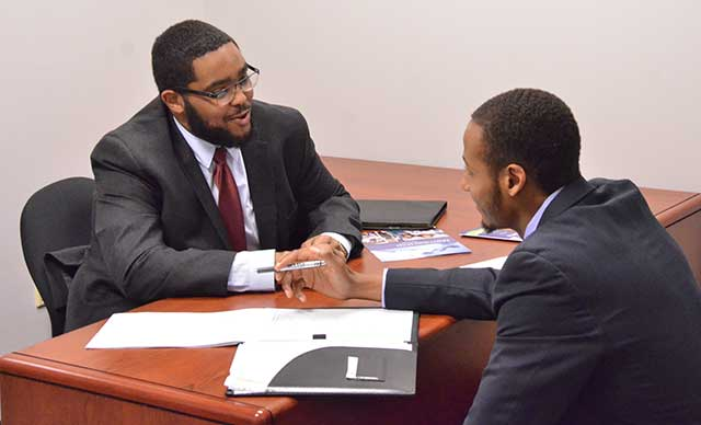 NC A&T State accounting graduate DeSean Jordan (left) conducts an interview with student Charles Chisley IV.