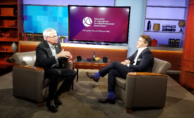 Barry Melancon, CPA, CGMA, CEO of the Association of International Certified Professional Accountants, left, discusses cybersecurity with Shark Tank star Robert Herjavec (Association photo)
