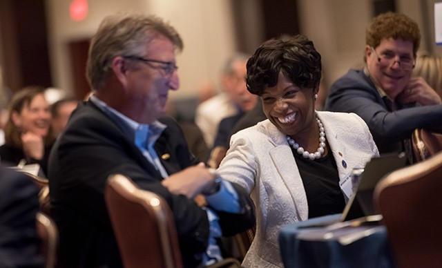 Kimberly Ellison-Taylor, seen here at the 2015 AICPA spring Council meeting with past board chairman Bill Balhoff, left, wants to ensure that the profession remains strong with more people entering than leaving.