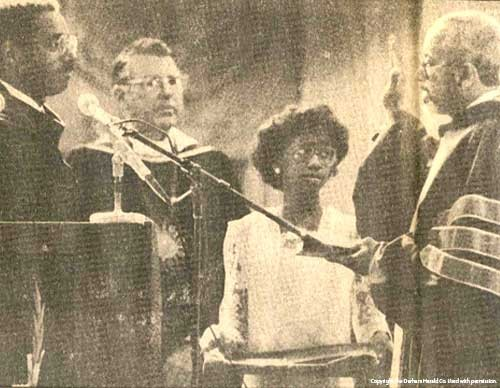 Kelly Richmond Pope watches her father, Dr. Tyronza Richmond (right), as he is sworn in as chancellor at North Carolina Central University in Durham, N.C., in 1986.
