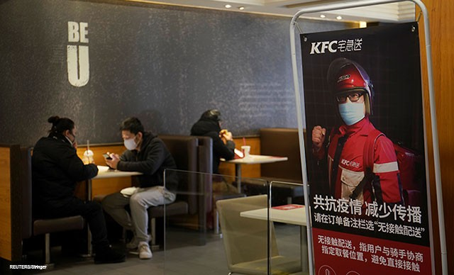 An advertisement promoting KFC's delivery service is seen inside a KFC restaurant as the country is hit by an outbreak of the novel coronavirus, in Beijing, China, February 8, 2020.