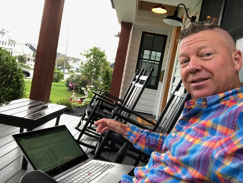 Jim Bourke, CPA/CITP/CFF, CGMA, a partner and managing director of advisory services for N.J.-based regional accounting firm WithumSmith+Brown, working on the front porch of his home in New Jersey.
